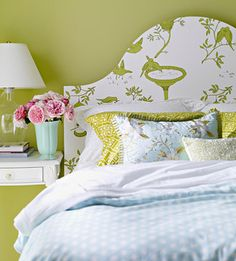 Wall papered headboard.