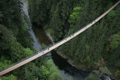 Capilano Suspension Bridge; Vancouver, Canada.  The Reason to Go: Gain a new perspective of the world when you walk across the 230-feet high footbridge that stretches 450 feet above the Capilano River.