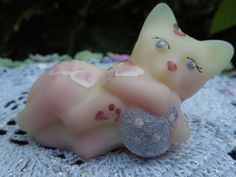 what a cute fenton cat.  that is/was selling on e-bay.  love it.