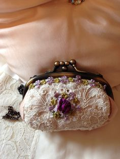Small silk purse; vintage lace with ribbonry.