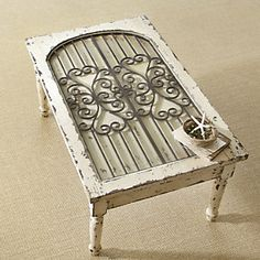 This is a great idea for a table - made from a salvaged window grate.