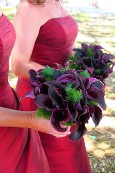 Dark plum, almost black calla lily flowers, made with ming fern and kawakawa leaves in bridesmaids bouquets.