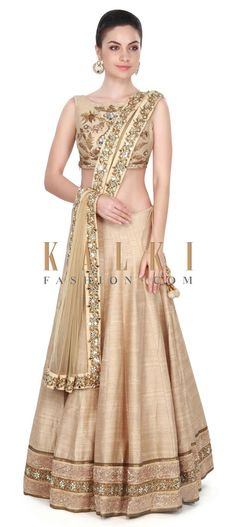 Buy this Beige lehenga adorn in floral motif embroidery only on Kalki