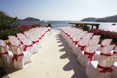 Vibrant fuchsia sashes add punch to the stark white chair covers