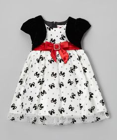 Dressing to the nines will be quite the fuss-free affair when this fancy frock is invited to the party. Aside from the adorable bow pattern, it also boasts a shining red bow and attached velvety shrug.