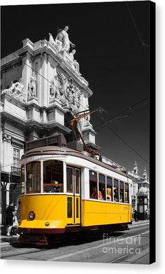 Lisbon's Typical Yellow Tram In Commerce Square Canvas Print by Jose Elias - Sofia Pereira