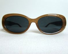Vintage sunglasses. Brown frame, black lenses. Sunglasses are in a very good vintage condition. The frame and lenses contain only minor signs of