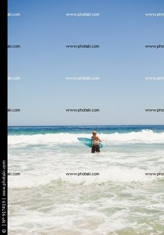 http://www.photaki.com/picture-young-blonde-man-returning-to-the-beach_917419.htm