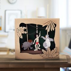 Hast du einen leeren Schuhkarton übrig? Verwandel ihn in ein Dschungelbuch-Puppentheater!