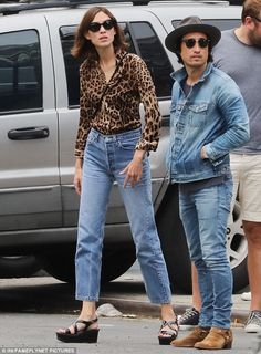 Into the wild: Alexa Chung, 32, channelled her wild side as she headed out with pals in New York, on Saturday, in a striking buttoned down leopard-print shirt
