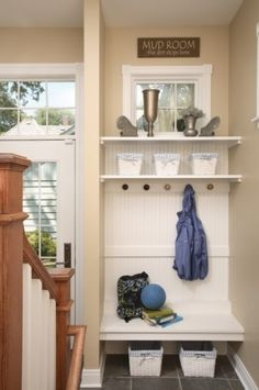 Cute mudroom style nook for a small space or former coat closet.