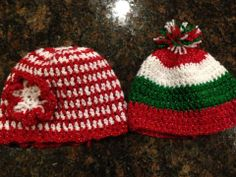 Red and white crochet hat with flower $10.00 Red, Green and white crochet hat with pom pom $10.00 Hat can be made in any color combinations or size Hats made by Dots of Love Creations Dotsoflovecreations@gmail.com
