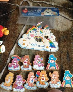 HUGE lot of wooden Vintage Care Bear statutes with Care A Lot display