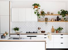 Killer kitchen inspo this morning via @cantileverinteriors . So much to love here locally designed and manufactured in Melbourne as well as being sustainable. It's ticking all the right boxes. White kitchen subway tiles open timber shelves greenery = . Reminds me so much of my old kitchen which I loved entertaining in! Photo @gemmola fab styling by @ruthwelsby #supportlocalbusiness #australiandesigners #melbournemade #kitchendesign by michelle_baskinteriors