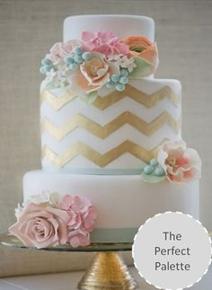 The cake will feature clusters of green succulents, blush pink spray roses, and white sweet peas