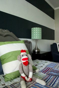 Navy and white striped wall, toddler room, navy green big boy room, sock monkey, pottery barn madras quilt