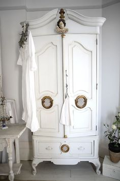 Thrift a vintage piece of furniture and paint white. Perfect gift for the lady who loves home