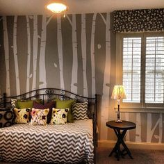 Decorating Walls With Tree Decals - Birch trunks:  Looks at these subtle grey walls where only the birch trunks are visible than any of its leaves or branches. This kind of décor will make the room look very contemporary and artistic too.