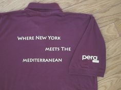 """You're seeing the back and right shirt sleeve of a custom polo JessE Designs created for Pera Soho restaurant in NYC.  """"Where New York Meets the Mediterranean"""" is the restaurants theme as Turkish/Mediterranean cuisine is enjoyed at Pera's two NYC locations."""