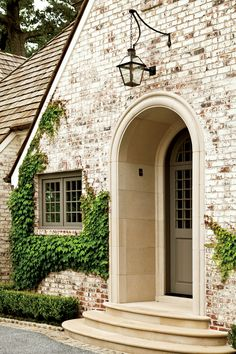 Notice the Details: The Limewash - New House Gets a Makeover - Southernliving. The custom mixture of lime, pigment, and water penetrates the brick facade, rather than forming a layer over it, resulting in a finish that has instant patina and House Design, House, Brick Exterior House, House Exterior, Exterior Brick, Exterior Design, New Homes, Brick, Exterior Makeover