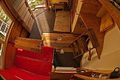 """The """"door"""" in the floor hides the sunken tun. Could you live in this tiny cabin? I could!!"""