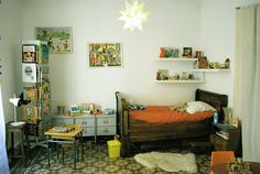 cute kids room. look at that antique bed.