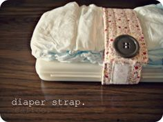 Brilliant!!!!! Diaper strap - keeps diaper and wipes together in the big purse! I think I'll make this with velcro instead so it can fit 1 or 2 diapers.