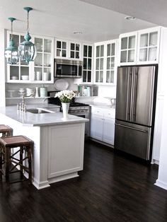 Grace and Collin's Coastal Cottage. Kitchen. Small layout.