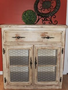Home Frosting: Distressed Cabinet w/ chicken wire door panels