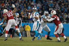 Cam Newton #1 of the Carolina Panthers looks to pass in the first half against the Arizona Cardinals during the NFC Championship Game at Bank of America Stadium on January 24, 2016 in Charlotte, North Carolina. (Jan. 23, 2016 - Source: Grant Halverson/Getty Images North America)