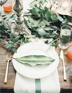 Play up your natural themed wedding with some playful leaf place cards with all of your guests written on them!
