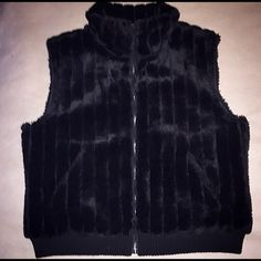 """Faux mink fur vest, full zip L/XL (MI IT brand) faux fur vest. 100% acrylic. Machine washable. Full zip, ribbed waist, lined, front pockets. No signs of wear. About 22"""" armpit to armpit, about 25"""" from top of tear collar to bottom. Chic and cozy.  no trades no PP Jackets & Coats Vests"""