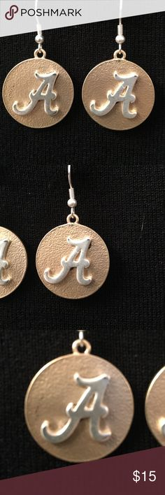 """Alabama pierced Earrings silver A on gold disk Alabama Pierced Earrings Silver A on gold disk.  Never been worn.  Disk is approximately 1"""" x 1"""". Hang Down about 2"""".  Licensed seal on back of card HJC Jewelry Earrings"""
