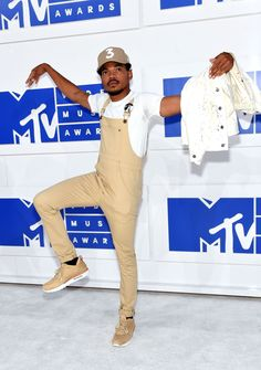Chance the Rapper wore tan overalls to the 2016 MTV Music Video Awards, a place where many trend-setting artists like himself show up in trendy ensembles. Overalls are a trend that always seem to come back and Chance's tan version are sure to set the pace for both men and women's fashion this fall. Lexis G.