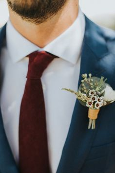 Boho boutonniere idea - wax flower for groom's boutonniere {Michael Stephens Photography}