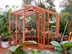 I wish I had this greenhouse.  It even has a mister and heater system.  Also the air vents on the roof are solar powered!