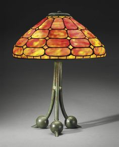 TIFFANY STUDIOS A DICHROIC TABLE LAMP, CIRCA 1910 leaded glass, patinated bronze 21¼ in. (54 cm.) high, 16¼ in. (41.3 cm.) diameter shade stamped TIFFANY STUDIOS NEW YORK 159, base stamped TIFFANY STUDIOS NEW YORK 482