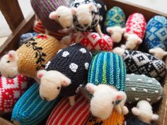 Mary Kilvert makes the most adorable sheep, with wool roving-wrapped bodies and knitted coats. I am desperately in love!