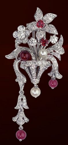Cartier brooch set with Ruby, Pearls and Diamonds.