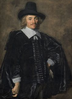 Restoration Period. This man is also wearing a hat with a wide brim. He is wearing a coat with straight sleeves, turned out cuffs, and buttons down the front. He has a cape on and an large collar turned out from his doublet underneath the coat.