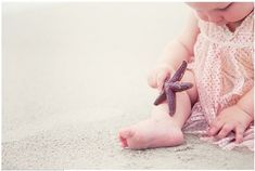 Beach Baby- cute pic! Like the idea of giving baby a shell or starfish to keep her occupied.