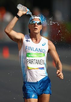 VeliMatti Partanen of Finland pours water on himself during the Men's 50km Race…