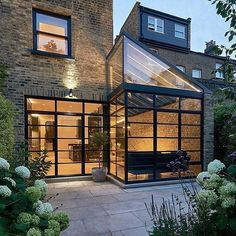Architect Blee Halligan added a new light-filled kitchen and dining room to a four storey victorian terrace house in Highbury England. Modern Exterior, Exterior Design, Glass Extension, Rear Extension, London House, House Extensions, Brickwork, Facade House, Patio Doors