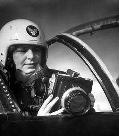 LIFE photographer Margaret Bourke-White sporting a US Air Force helmet while  holding a large camera in the cockpit of an airplane during her assignment at  Strategic Air Command's Carswell Air Force base. Italy, April 1951.
