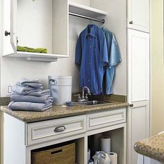 Cabinets stretch to the ceiling in the mudroom, which doubles as a laundry room. An upper cabinet in the mudroom/laundry conceals a chute for dirty clothes that originates in the master bedroom closet. | Photo: Dominique Vorillon | thisoldhouse.com