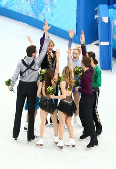 Bronze medalists the United States figure skating team Simon Shnapir, Maria Castelli, Gracie Gold, Ashley Wagner, Meryl Davis, Charlie White, Jeremy Abbott and Jason Brown celebrate during the flower ceremony for the competes in the Team Ladies Free Skating during day two of the Sochi 2014 Winter Olympics at Iceberg Skating Palace on February 9, 2014 in Sochi, Russia.