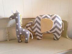 customizable Modern zoo animal decor pillows by RaggedyRAD. giraffe and elephant baby nursery decor. gray and yellow chevron and polka dot baby gifts.