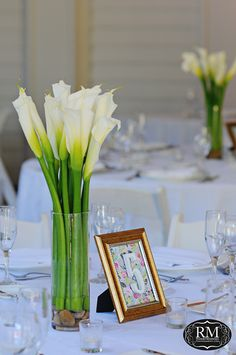 Simple but beautiful White Calla Lilies centerpiece accented by DIY framed table number | Rosie Mendoza Photography