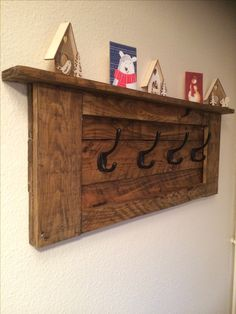 Rustic wooden coat rack with cast iron hooks. Upcycled from old wood pallet