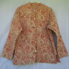 """Quilted Reversible Jacket Paisley Floral Here's a cute quilted reversible jacket that is in very good condition with only gentle wear.  Has a paisley pattern on one side and a floral pattern on the other. With garment laying flat measurements are Chest 22"""" Shoulder 18"""" Arm Pit to Bottom Hem 17"""" Shoulder to Bottom Hem 26"""" Waist 24"""" Sleeve 23' Jackets & Coats Blazers"""